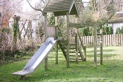 Single Tower Play Frame with Steps, Slide, Vertical Bars and Climb Net